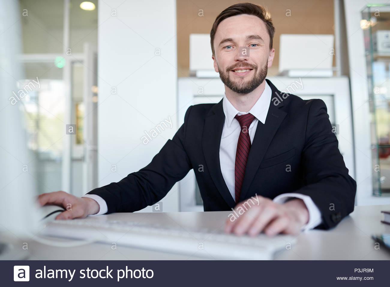 handsome-business-manager-at-desk-P3JR9M